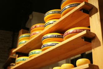 This picture shows storage shelves supported by angle irons. The shelves hold cheese. Small image.