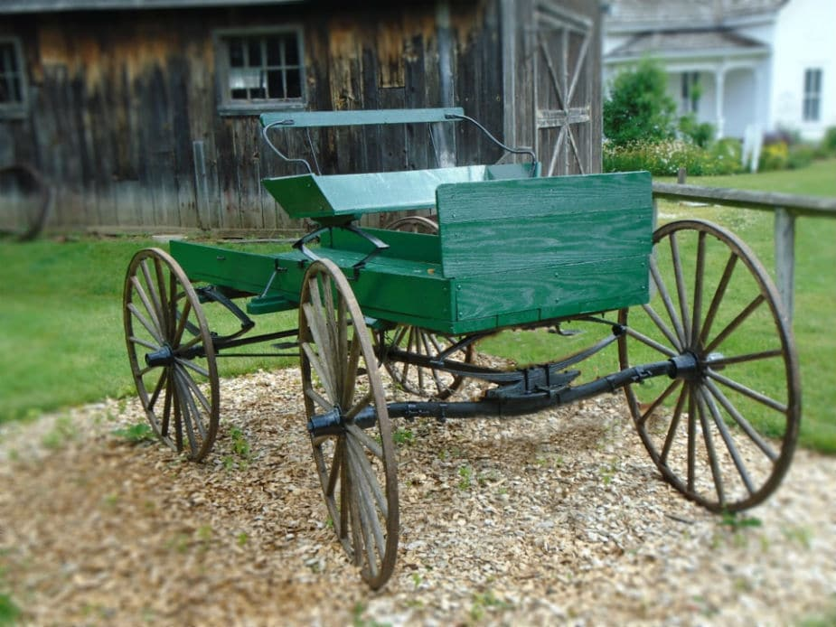 This is a picture of a green wooden carriage. Large image.