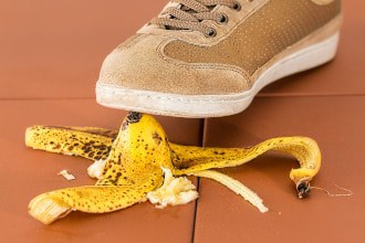This picture shows a foot about to slip on a banana peel. It symbolizes a safety hazard.