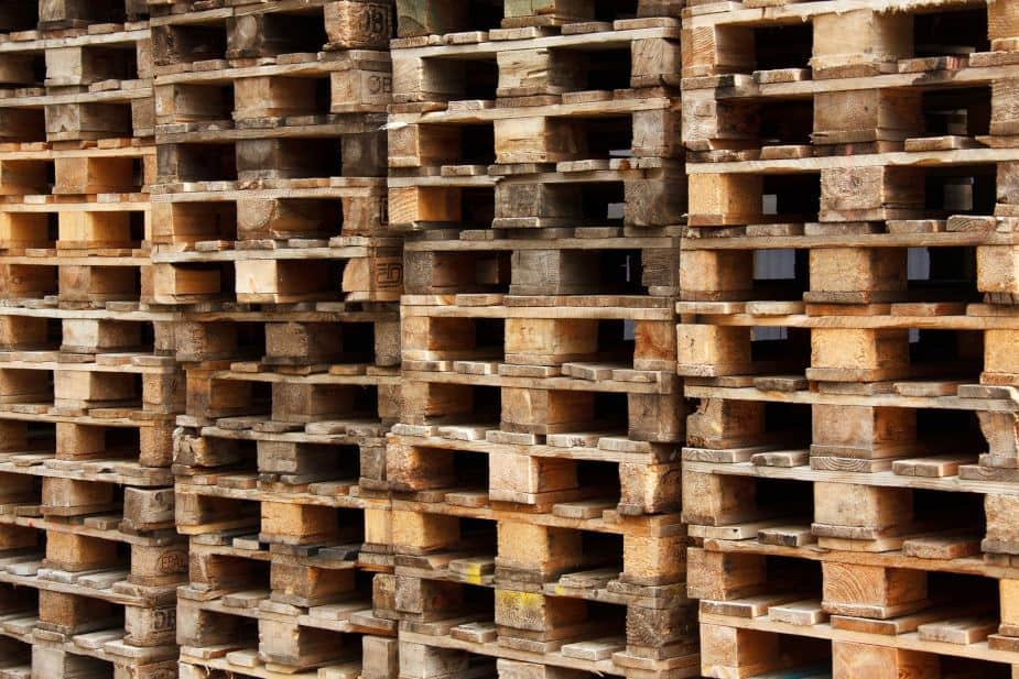 This picture shows a collection of wooden pallets with some cleaner than others.