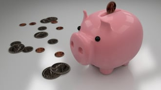 "This image shows a piggy bank with coins. It symbolizes ""saving money""."