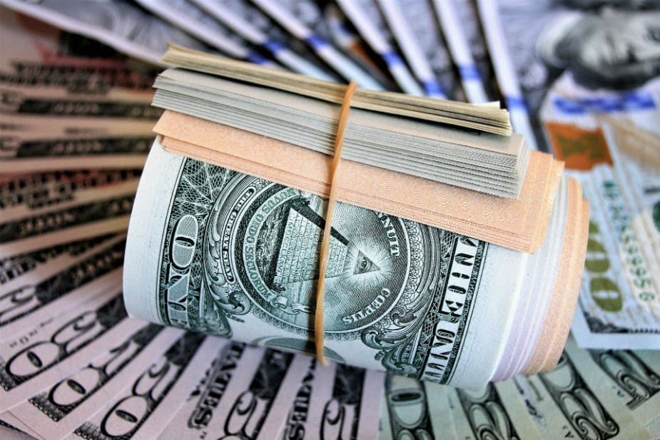 This is the main image for the 3 Ways To Make Money Off of Woodworking blog post. It shows a wad of rolled up cash. Large image.