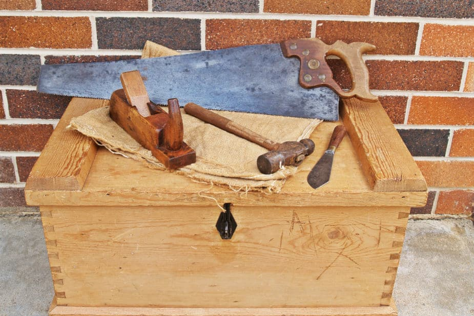 This shows several tools on a wooden box.
