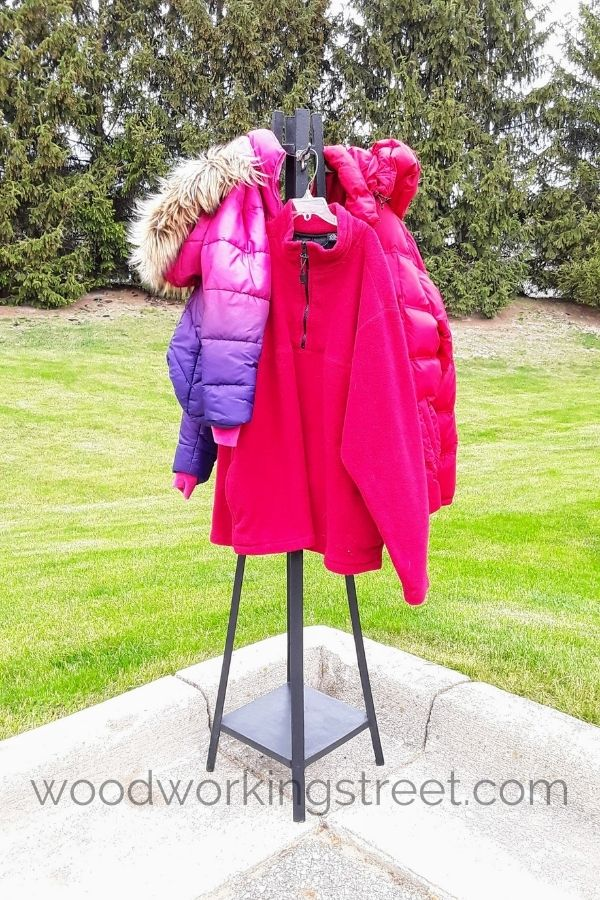 freestanding coat rack outside with green grass