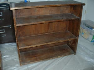 Wooden bookcase with brown stain