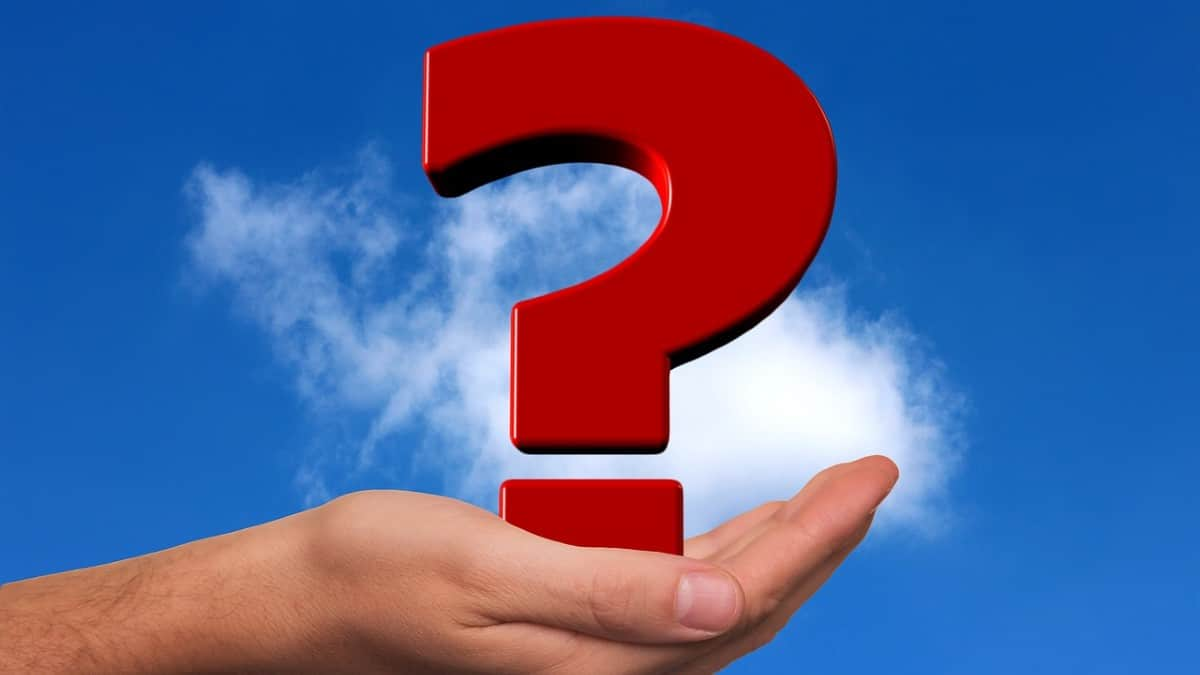 red question mark with blue sky background