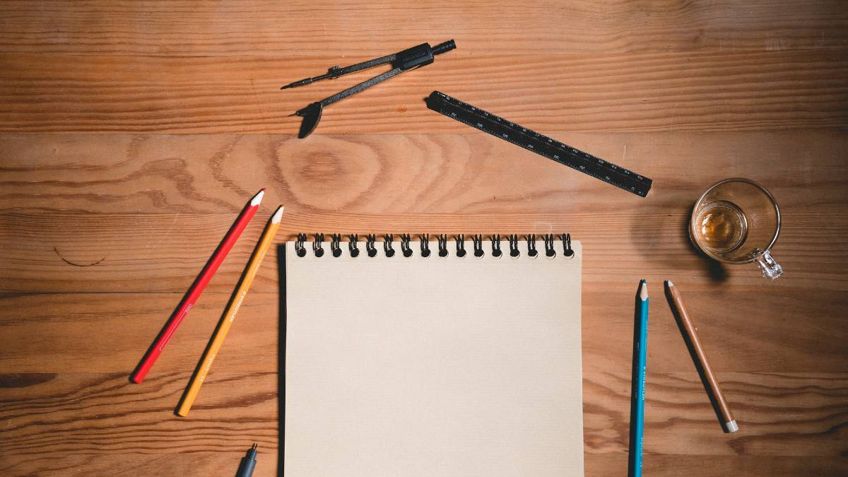 drawing tools on table with glass cup